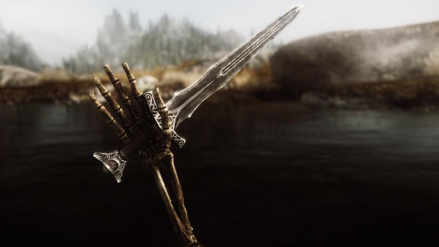 Skeletal Hand Holding Sword